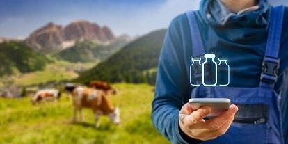Milchtechnologe mit Kuh